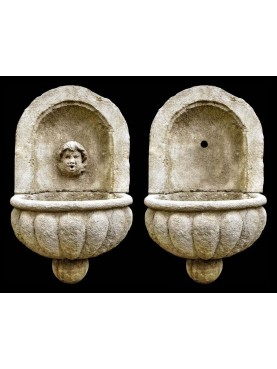 Stone fountain with basin and mask