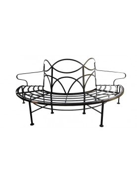 Semicircular iron bench with high espalier tree